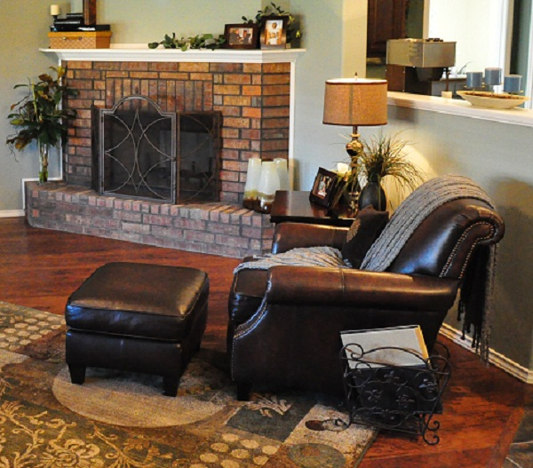 Betenbough Homes North Park Model Home - living room with fireplace sitting area