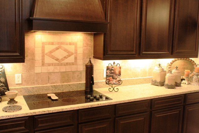 Add personality to your kitchen with a tile backsplash house made home - Kitchen backsplash medallion ...