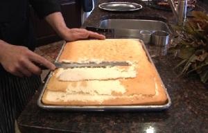 cutting top of cake