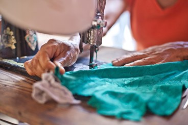 Homes for Hope loan recipient sewing
