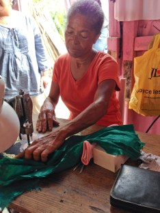 A woman in the Dominican Republic who received a HOPE International loan for her clothing business.