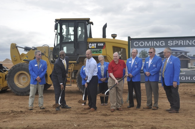 Councilman, John Love, Betenbough Homes Midland General Manager, Eric Miller and Ron Betenbough participate in groundbreaking.