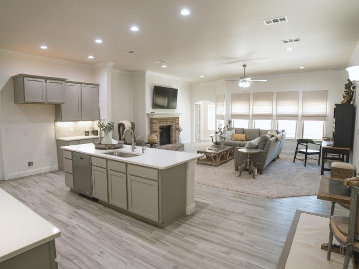 open floor plan with quartz countertops